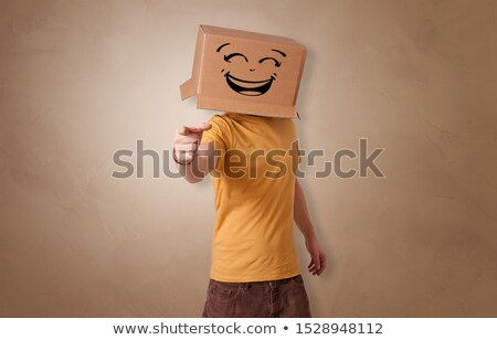 Man with cardboard box on his head and pleasing face expression Stock photo © stevanovicigor