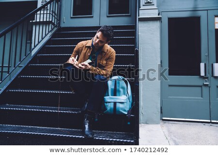 thoughtful young man is sitting down Stock photo © feedough