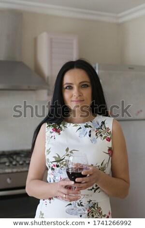 Hermosa joven vidrio vino negro Foto stock © Nejron