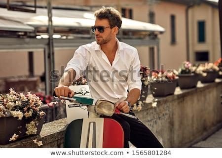 jóképű · férfi · napszemüveg · ül · gondolkodik · áll · pihen - stock fotó © stryjek
