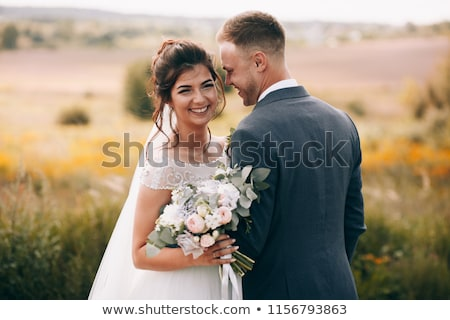 Happy Bride and Groom Married Outdoors in a Forest Stock photo © tobkatrina