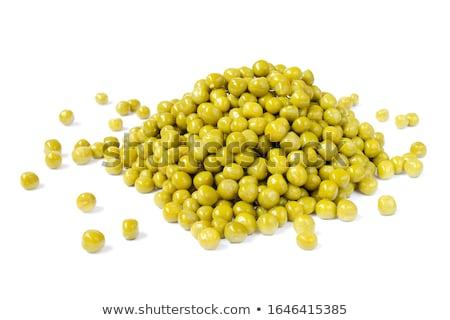 Dobozos zöldborsó étel asztal zöld labda Stock fotó © yelenayemchuk