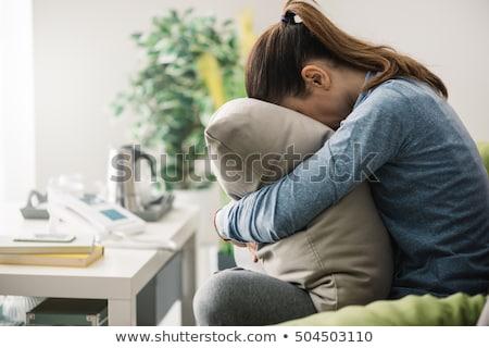 Szomorú lány ül kanapé ölel párna Stock fotó © feelphotoart
