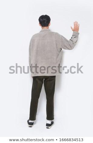 Asya · adam · klasörler · ayakta · beyaz - stok fotoğraf © deandrobot