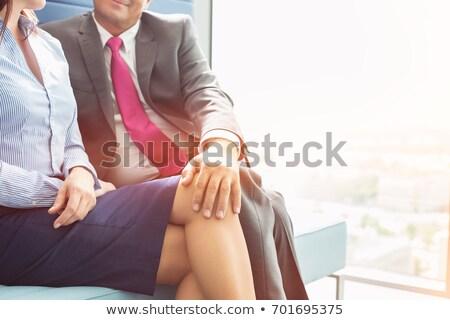 businesswoman and businessman flirting stock photo © andreypopov