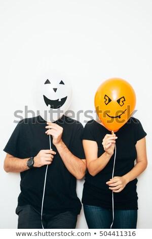 Lachend man verbergen gezicht geïsoleerd witte Stockfoto © d13