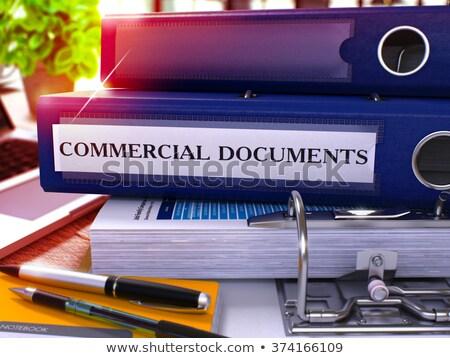 Red Office Folder with Inscription Commercial Documents. Stock photo © tashatuvango