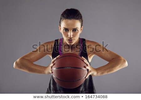 sports woman posing with basketball ball stock photo © deandrobot