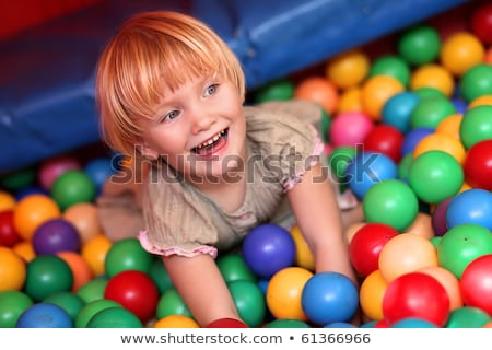 little girl lies on multi-coloured plastic spheres Stock photo © Paha_L