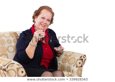 Senior Woman at her Seat Inviting to Have a Tea Stock photo © ozgur
