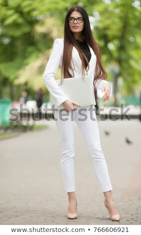 Young businesswoman relaxing on an outdoor bench Stock photo © dash