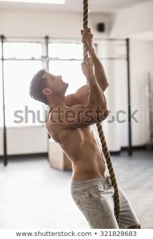 Yandan görünüş kas adam halat tırmanma crossfit Stok fotoğraf © wavebreak_media