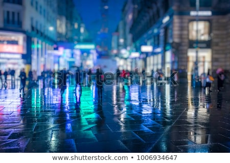 crowd people walking in the city at night stock photo © zurijeta