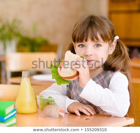 Fiatal lány szendvics nagy fehér étel háttér Stock fotó © bluering