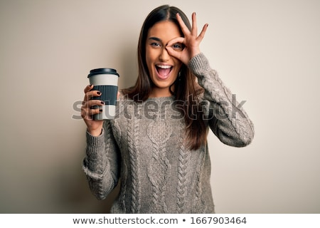 woman holding cup isolated on white stock photo © artjazz