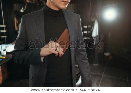 businessman putting money in shirts pocket stock photo © shutswis