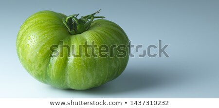 Tomato with green tail Stock photo © artjazz