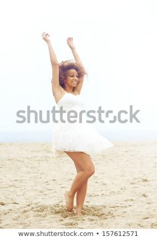 かなり 若い女性 ドレス ダンス 裸足 ビーチ ストックフォト © deandrobot