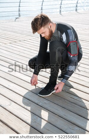 vertical image of runner preparing near the sea stock photo © deandrobot