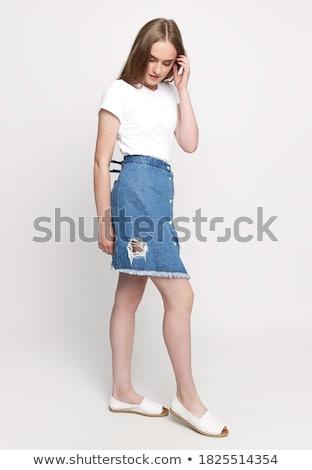 Fiatal csinos barna hajú nő farmer rövidnadrág Stock fotó © iordani