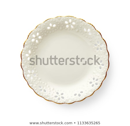 Porcelain plate with lattice edge Stock photo © Digifoodstock