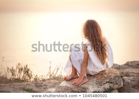 Sad angel looking at the occean Stock photo © konradbak