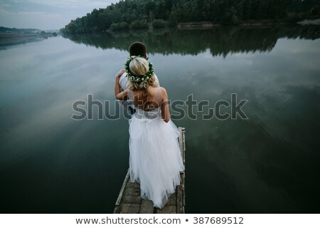 wedding couple on the old wooden pier stock photo © tekso