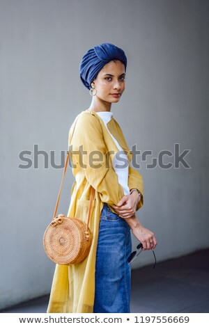 Stylish woman posing in sunglasses and scarf on head Stock photo © julenochek