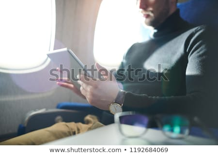Mid section of businessman reading book Stock photo © wavebreak_media