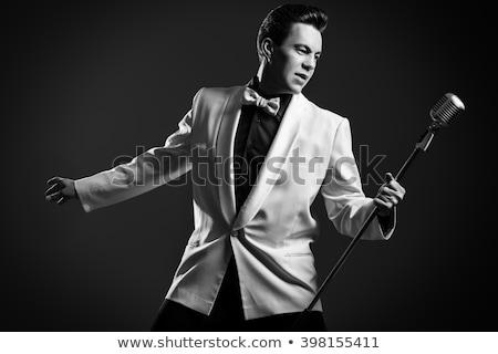 улыбаясь · красивый · молодым · человеком · гитаре · пения · микрофона - Сток-фото © wavebreak_media