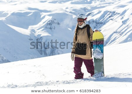 Woman snowboarder on the snow slopes on sunny winter day Stock photo © Nobilior