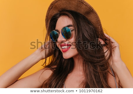 portrait of woman in black hat looking to camera on white Stock photo © LightFieldStudios