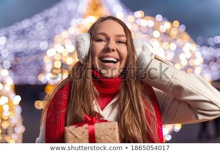 Gülümseyen kadın eşarp genç eldiven poz Stok fotoğraf © LightFieldStudios