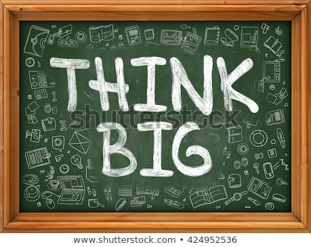 Hand Drawn Think Big on Green Chalkboard. Stock photo © tashatuvango
