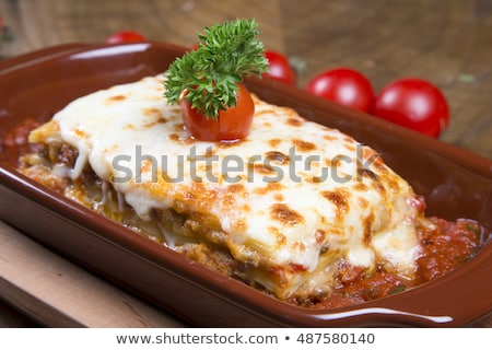 meatballs stewed with vegetables on wooden table top view stock photo © yelenayemchuk