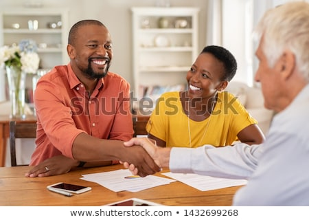 Financial advisor with a couple Stock photo © IS2