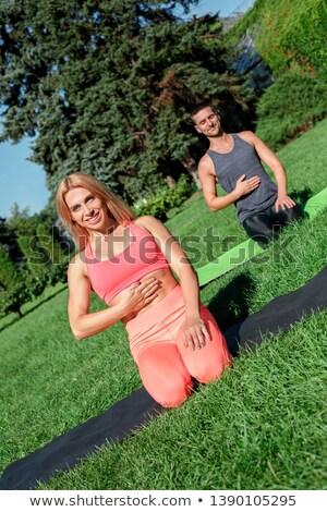 Woman practicing yoga outdoors in park Stock photo © artfotodima