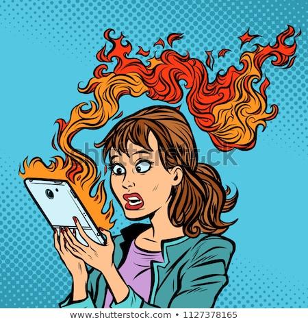 Kadın yanan telefon sıcak haber ateşleme Stok fotoğraf © rogistok