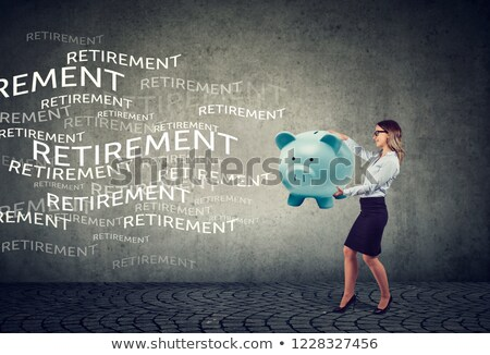 business woman attracting retirement funds with magnet piggy bank stock photo © ichiosea