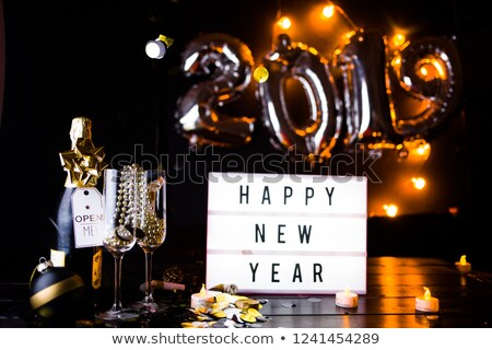 Stock photo: New Year 2019 gold glitter glass toast card