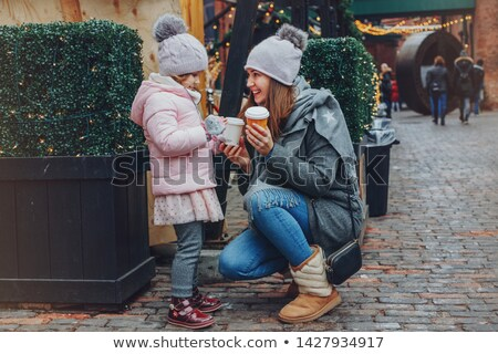 family with food and drink at christmas market stock photo © kzenon