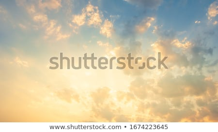 Fluffy clouds on yellow sky Stock photo © colematt
