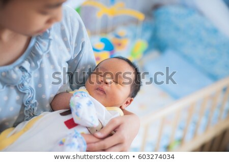 Cute девочку колыбель ребенка комнату сестра Сток-фото © Lopolo