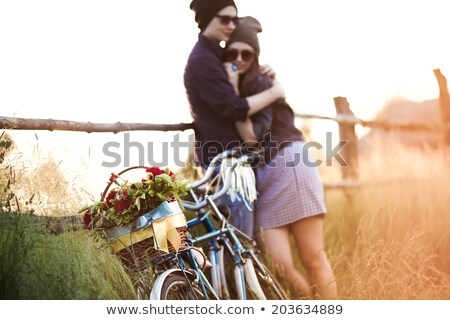 happy couple with fixed gear bicycles in summer Stock photo © dolgachov