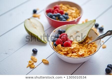 Gouden cornflakes vers vruchten frambozen bosbessen Stockfoto © dash