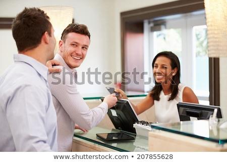 Feliz homossexual homens quarto de hotel férias casal Foto stock © diego_cervo