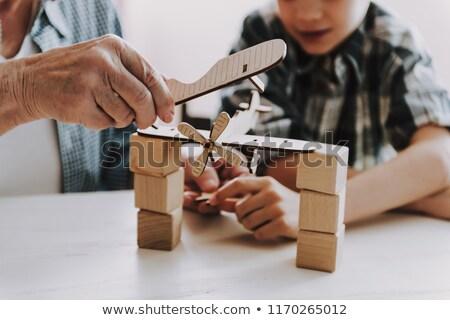 Grand-père petit-fils mains tenant famille génération Photo stock © dolgachov