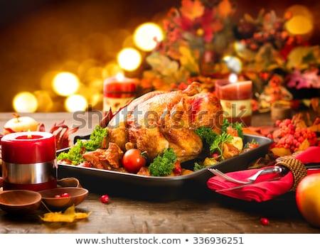 karácsony · vacsora · piros · gyertya · ünnepel · ebédlőasztal - stock fotó © dolgachov