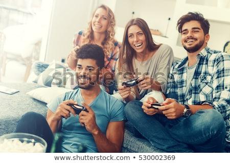 jonge · vrouw · verslagen · vriendje · video · game · gelukkig · home - stockfoto © lopolo