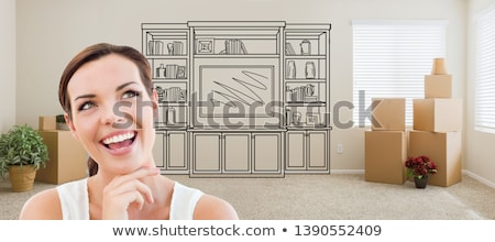 Woman Inside Room With Moving Boxes Glancing Toward Entertainmen Stock photo © feverpitch